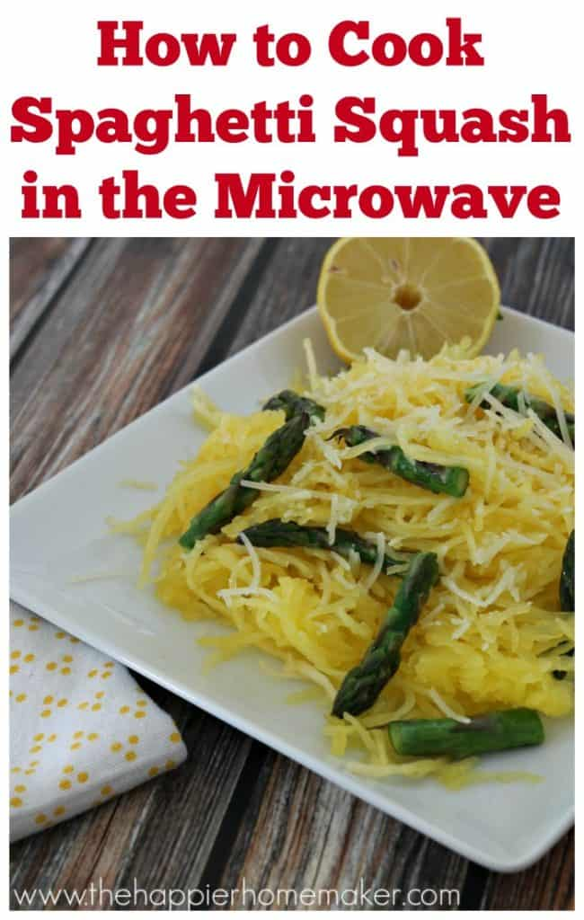 A close up of spaghetti squash garnished with asparagus lemons and cheese on a white plate