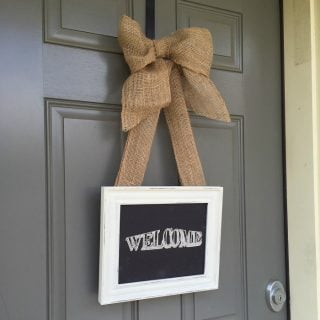 picture frame sign reading welcome hanging from burlap ribbon