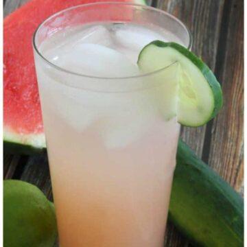 cucumber sunrise cocktail with cucumber garnish