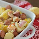 A close up of a lowcountry boil on a red and white napkin