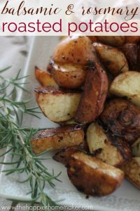roasted postatoes on a white plate with balsamic vinegar and rosemary
