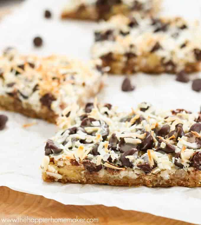 chocolate coconut bars on parchment paper