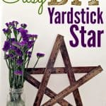 A DIY yardstick star next to flowers