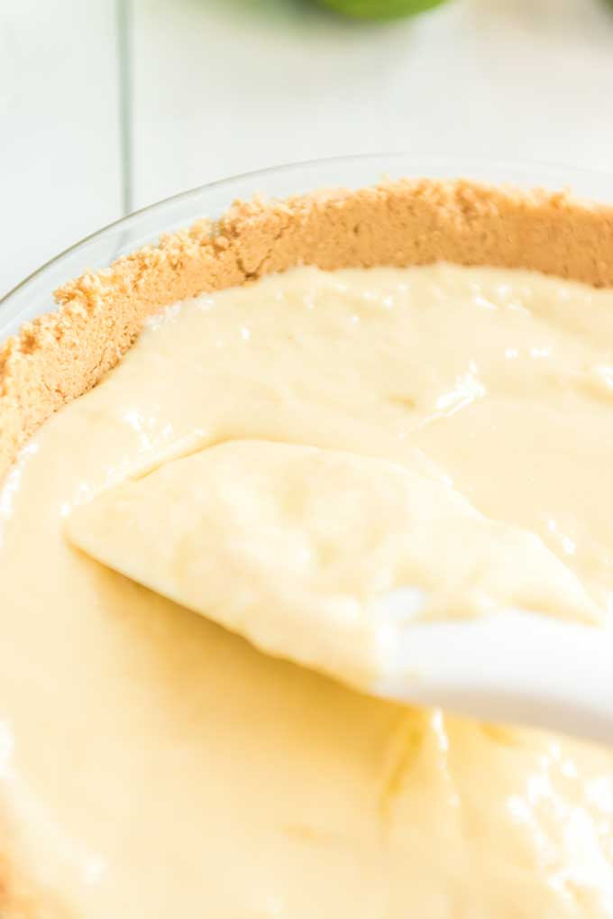 key lime pie filling in a graham cracker crust