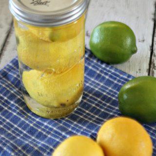 Lemons and limes on a blue napkin