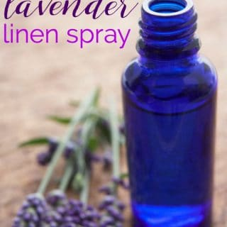 A close up of a blue bottle of lavender linen spray