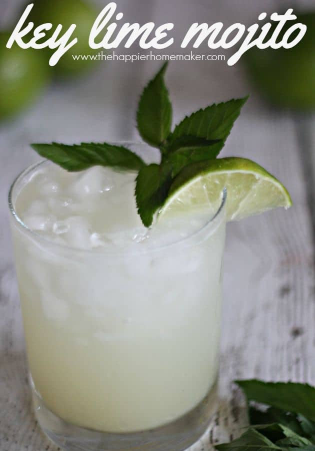 A glass of key Lime Mojito topped with a lime slice
