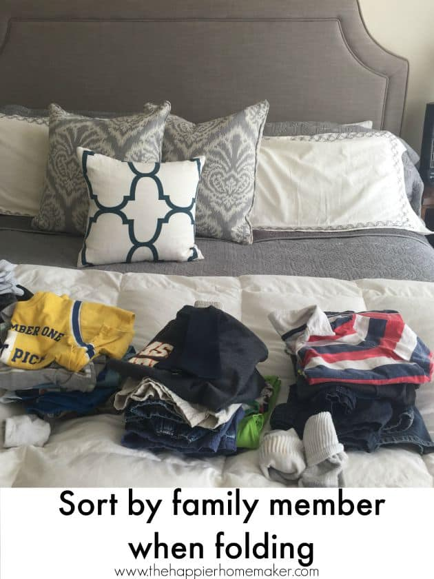 sorting clothes by family member