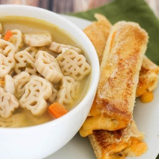 A bowl of soup and grilled cheese roll ups