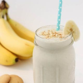 A banana pudding smoothie in front of bananas