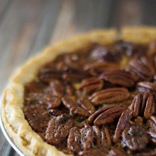 A close up of Nana's southern pecan pie on a wood table