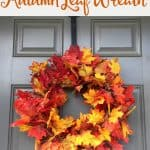 A close up of a fall wreath made of fakes leaves of different shades of autumn leaf colors