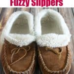 sheepskin lined suede tan slippers on wood floor