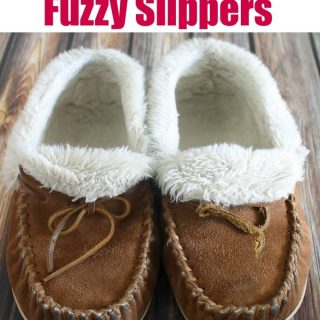 sheepskin lined suede tan slippers on wood floor