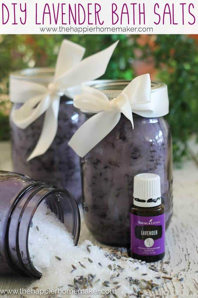 Three jars of lavender bath salts with lavender oil in front of them