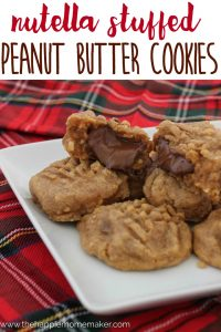 nutella stuffed peanut butter cookies on white plate with plaid napkin
