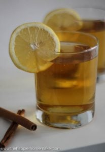 hot toddy in glass with cinnamon and lemon