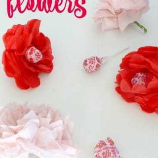 tissue paper flowers with lollipops for the stems and center