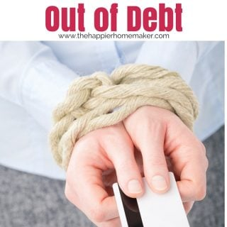 "The words ""out fo debt"" above a picture of a persons hands tied with rope while holding a credit card"