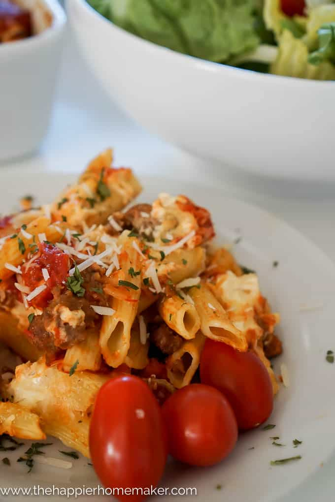 A close up of baked penne rigate topped with cheese