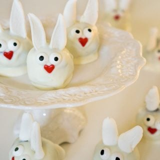 easter bunny truffles on white cake stand