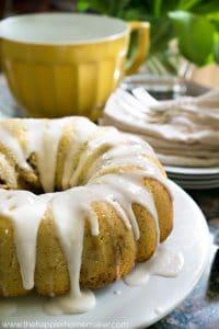 cinnamon roll coffee bundt cake with sugar glaze on white platter