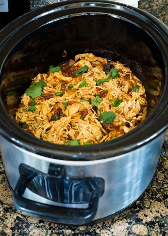 A slow cooker full of Mexican shredded chicken