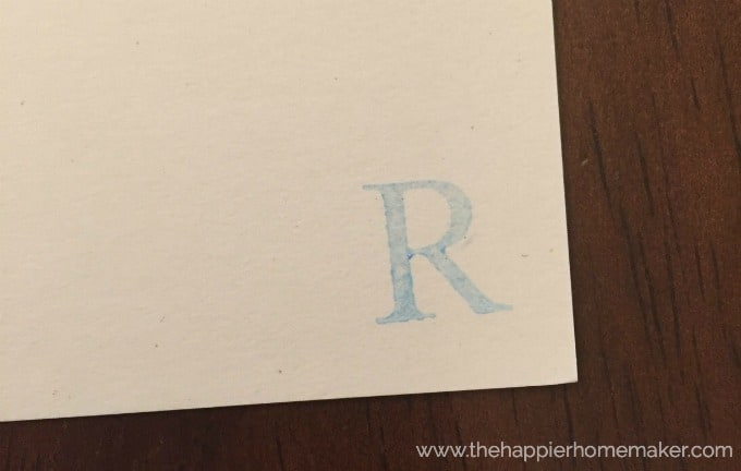 A blue print of the letter R on a piece of paper