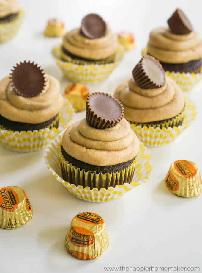 Reeses Peanut Butter Cup Cupcakes have a hidden chocolate peanut butter cup on the inside and the peanut butter frosting is insane! One of my favorite easy dessert recipes!