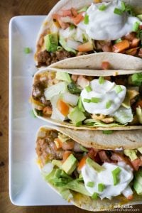 These oven baked tacos are a delicious and easy way to feed a crowd! Way less messy, especially for the kids!