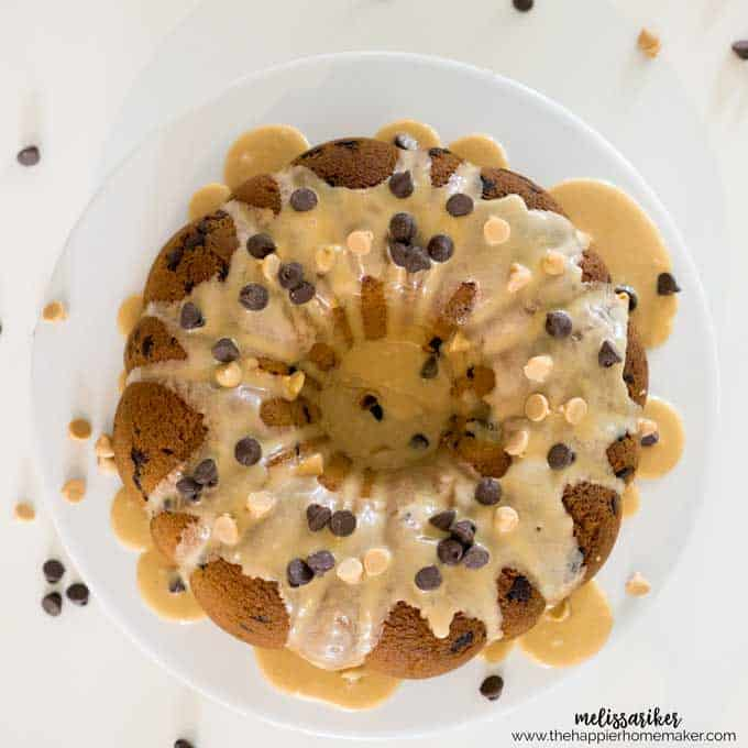 An above picture of peanut butter cake with chocolate chips topped with peanut butter glaze