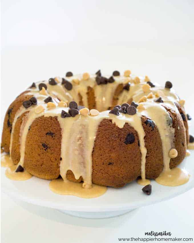 Delicious peanut butter cake with chocolate chips inside topped with peanut butter glaze and chocolate and peanut butter chips! A perfectly indulgent dessert recipe!