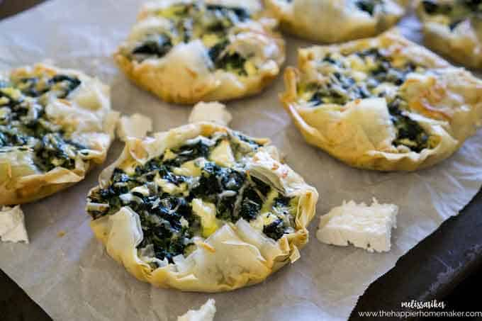A close up of spinach feta tarts