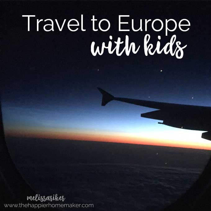 """A plane flying as the sun is setting with the words \""""travel to Europe with kids\"""""""