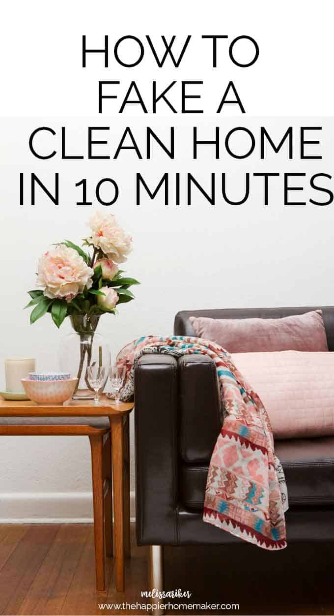 "The words ""how to fake a clean home in 10 minutes\"" over a sofa with pillows and a throw blanket next to a side table with flowers and glasses"
