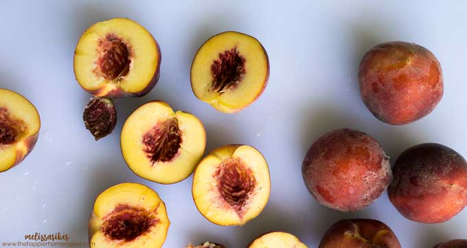 Halved peaches on a white background