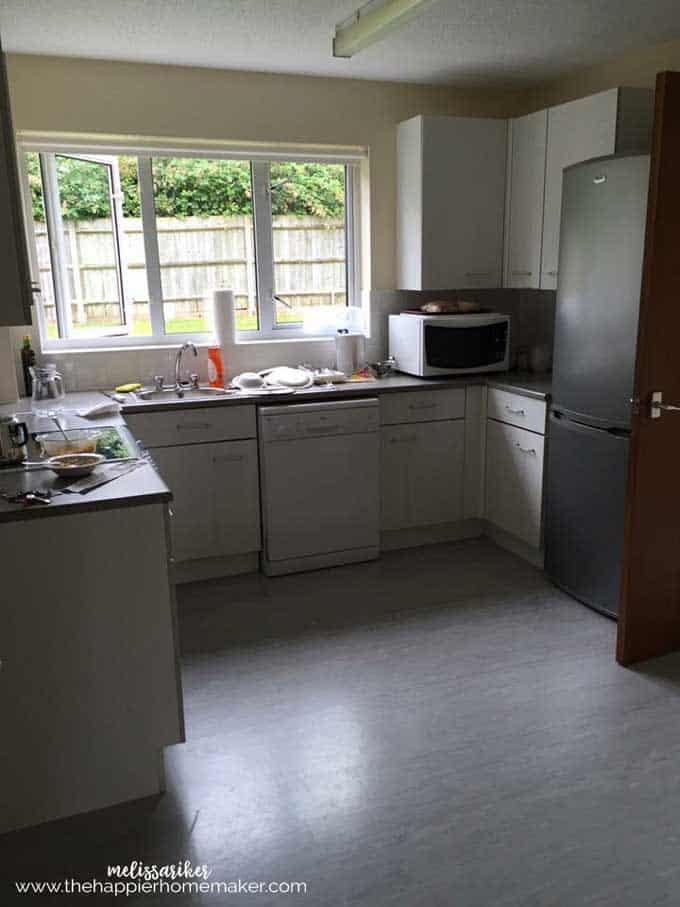 A plain white kitchen that is dark
