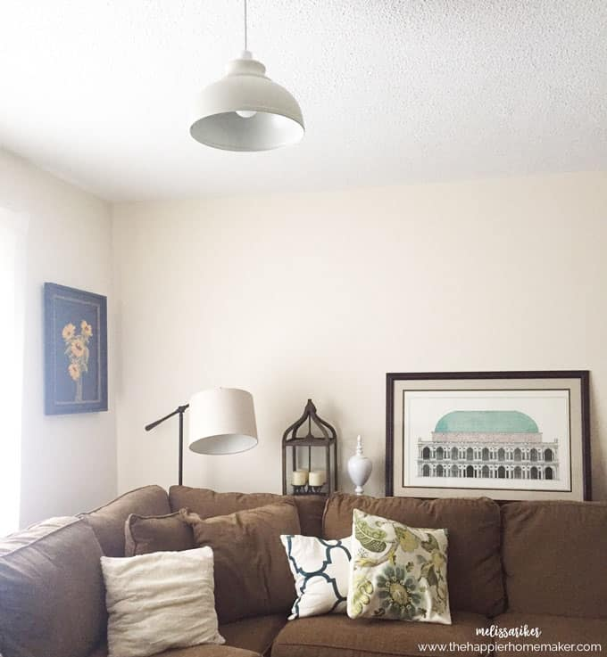 An after picture of a living room with furniture and paintings