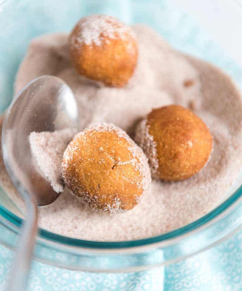 pumpkin doughnut holes in sugar with spoon