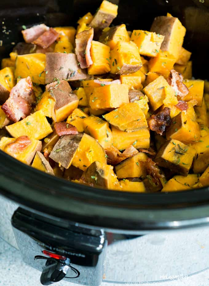 Slow cooker herbed sweet potatoes with crumbled bacon in a crock pot
