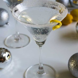 A Lemon drop Martini garnished with a twist of lemon peel