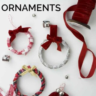 Easy Mason Jar Wreath Ornaments are a perfect way to use up extra jar lids and easy enough for kids to make at Christmas!