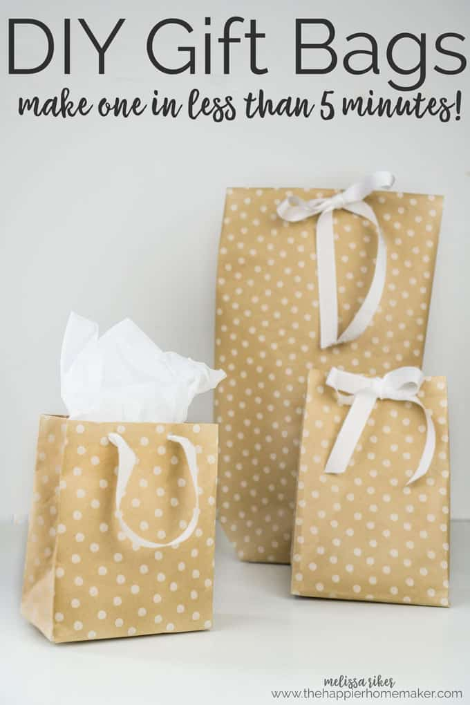 Three different sized gift bags with white ribbons