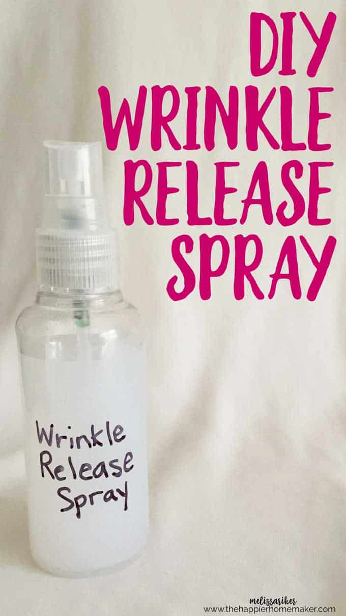 "A clear bottle with ""wrinkle release\"" written on it next to purple text reading \""Wrinkle Release Spray\"""