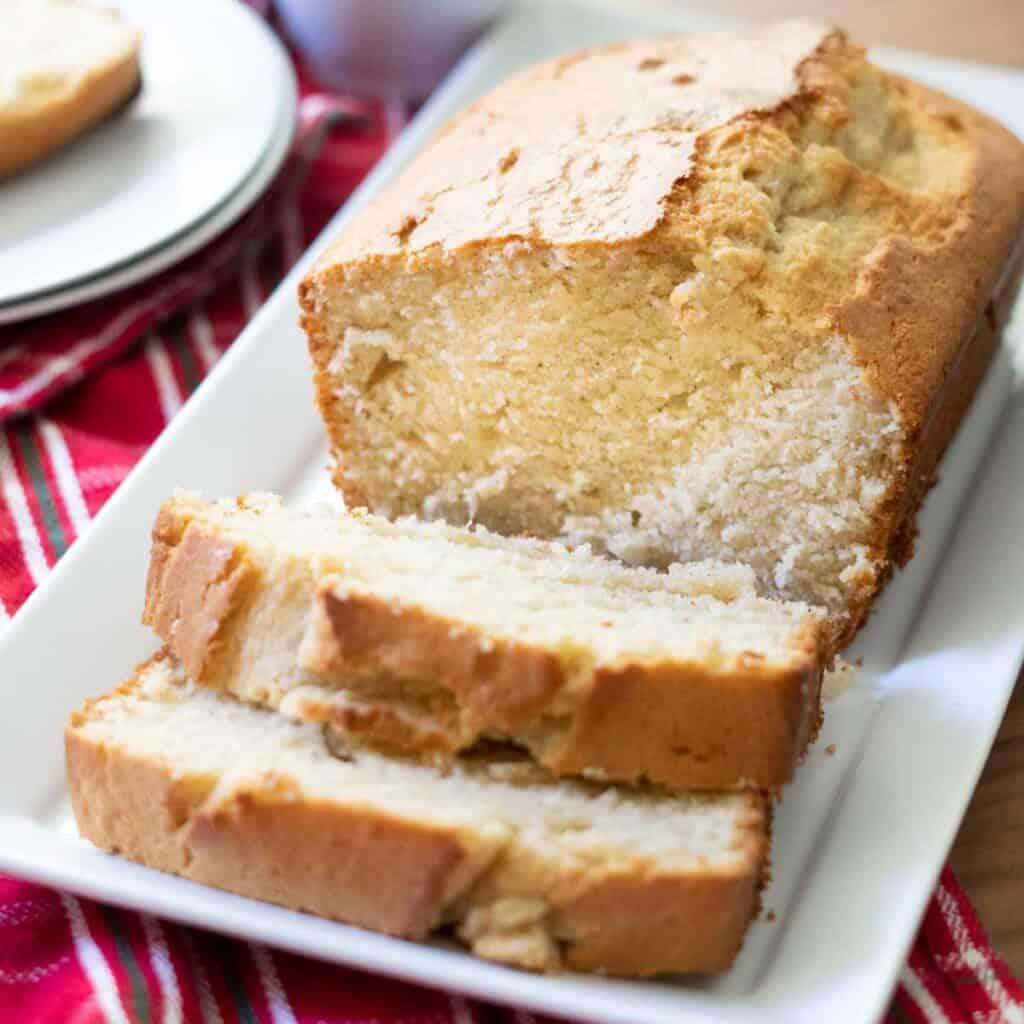 sliced loaf of eggnog bread on white plate