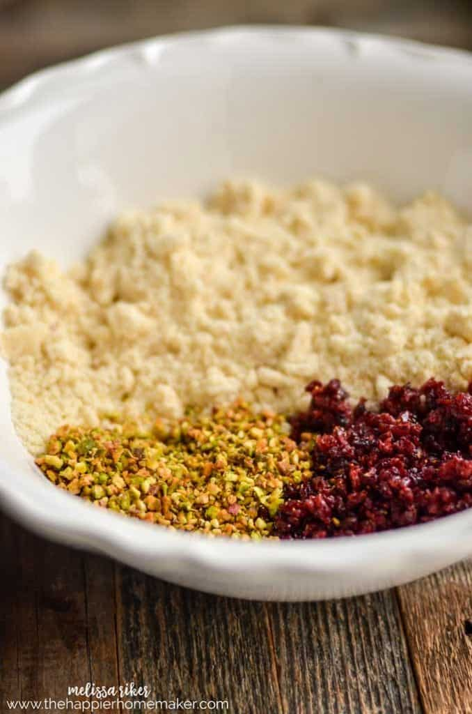 A close up of the ground ingredients for the shortbread cranberry and pistachio cookies
