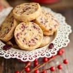A close up of shortbread cookies made with cranberries and pistachios