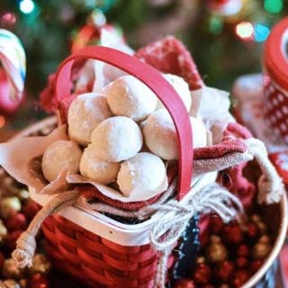 White almond snowball cookies in a red basket