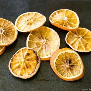 Several dried orange slices after baking on a pan