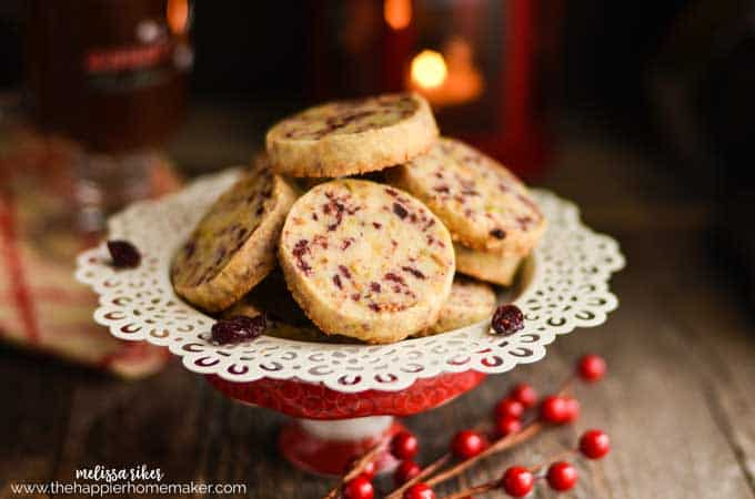 An after picture of cranberry and pistachio shortbread cookies in a white serving dish